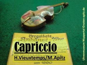 Capriccio Vieuxtemps / M. Apitz; Uhrenmuseum Wuppertal vergoldete Anhänge-Uhr (Armbanduhr) in Form einer historischen Violine bemalter Decke Schild in Schauvitrine : … Wien 1880 Sparte: 19. Jh. Konzert